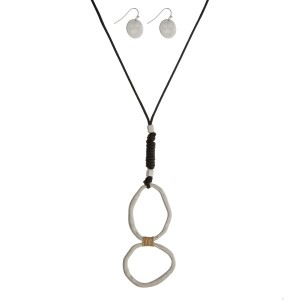 """Black cord necklace set with silver tone circle pendants and matching fishhook earrings. Approximately 26"""" in length."""