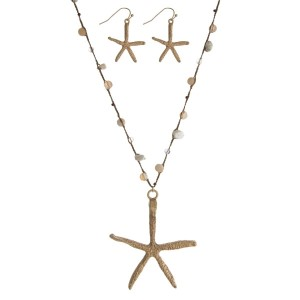 """Brown thread cord necklace with a gold tone starfish pendant and ivory chipstones along the cord. Approximately 36"""" in length."""