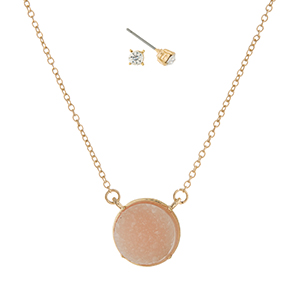 """Gold tone necklace set with a light pink circle faux druzy pendant and matching rhinestone stud earrings. Approximately 16"""" in length."""