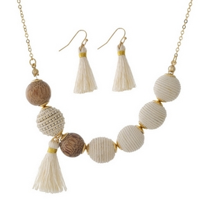 """Gold tone necklace set with ivory thread wrapped beads and wooden bead and tassel accents. Approximately 16"""" in length."""