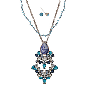 """Rose gold tone necklace set with a turquoise and blue rhinestone pendant and beaded accents. Approximately 18"""" in length."""