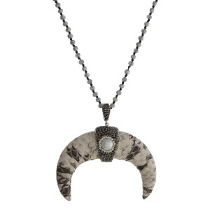 """Gray beaded necklace with a faux leather wrapped horn pendant. Approximately 32"""" in length."""