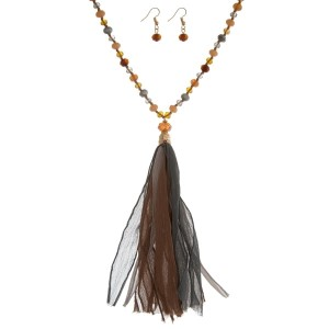 """Topaz, champagne, and gray beaded necklace set with a fabric tassel and matching fishhook earrings. Approximately 32"""" in length."""