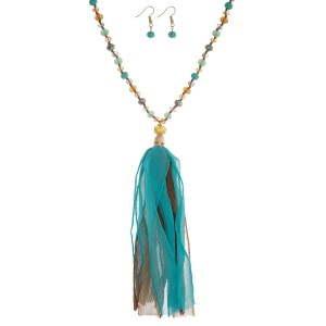 """Turquoise, gray and brown beaded necklace set with a fabric tassel and matching fishhook earrings. Approximately 32"""" in length."""