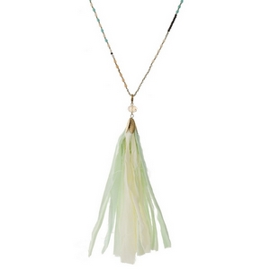 """Champagne and mint green beaded necklace with a mint green fabric tassel. Approximately 32"""" in length."""