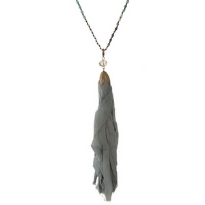 """Black and gray beaded necklace with a gray fabric tassel. Approximately 32"""" in length."""