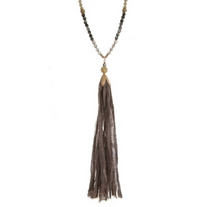 """Gold tone necklace with a gray beaded chain and a gray fabric tassel. Necklace is approximately 34"""" in length and tassel is 8"""" in length."""