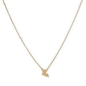 "Dainty gold tone necklace with a state of Louisiana pendant. Approximately 16"" in length."