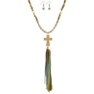 """Ivory beaded necklace set with a gold tone cross pendant and an olive green, tan and aqua fabric tassel. Approximately 32"""" in length."""