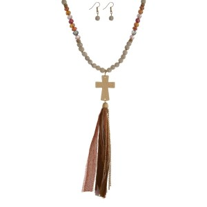 """Ivory beaded necklace set with a gold tone cross pendant and a brown, orange and tan fabric tassel. Approximately 32"""" in length."""