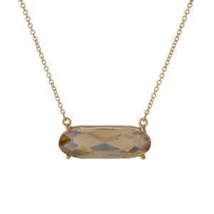 "Dainty gold tone necklace with a topaz rhinestone pendant. Approximately 16"" in length."