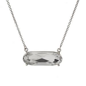 "Dainty silver tone necklace with a clear rhinestone pendant. Approximately 16"" in length."