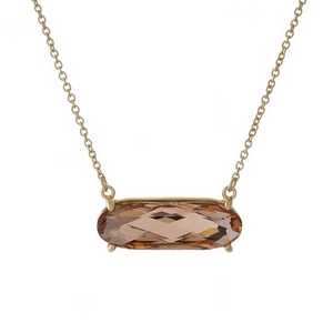 "Dainty gold tone necklace with a rose pink rhinestone pendant. Approximately 16"" in length."