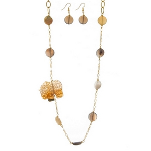 "Gold tone necklace set with beige and gray natural stones and a brown elephant pendant. Approximately 34"" in length."