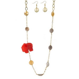 "Gold tone necklace set with beige and gray natural stones and a pink elephant pendant. Approximately 34"" in length."