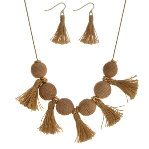 "Gold tone necklace set with beige thread wrapped balls and tassel accents. Approximately 16"" in length."