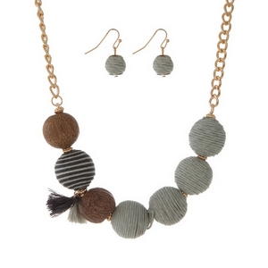 """Gold tone necklace set with gray thread wrapped balls and a tassel accent. Approximately 16"""" in length."""