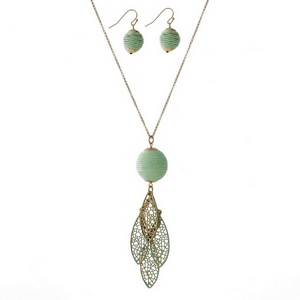 """Gold tone necklace set with a mint green thread wrapped ball pendant, a layered filigree pendant and matching fishhook earrings. Approximately 30"""" in length."""