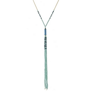 """Gold tone necklace with a light blue beaded tassel and thread wrapped accent. Approximately 32"""" in length."""