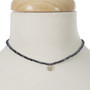 """Navy blue beaded choker with a gold tone pave charm. Approximately 12"""" in length."""