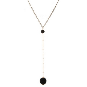 """Gold tone 'Y' necklace with black beads and a thread wrapped bead pendant. Approximately 26"""" in length."""