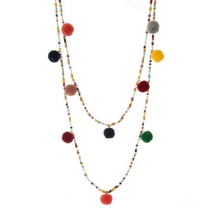"Multicolored beaded two layer necklace with pom pom accents. Approximately 26"" and 30"" in length."