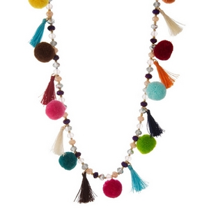 "Gold tone necklace with multi colored beads, pom poms and tassels. Approximately 28"" in length."