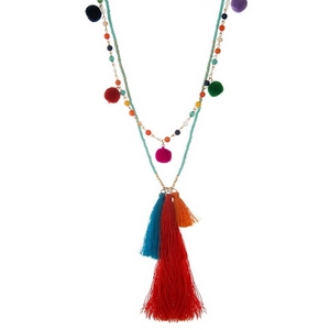 "Turquoise beaded necklace with multi-colored pom poms and a tassel pendant. Approximately 28"" and 30"" in length."