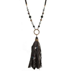 """Gray braided cord necklace with a large faux leather pendant and neutral colored beads. Approximately 36"""" in length."""