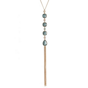 "Gold tone necklace with four light blue glitter stones and a chain tassel. Approximately 22"" in length."