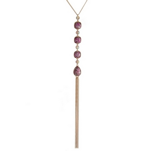 "Gold tone necklace with four fuchsia glitter stones and a chain tassel. Approximately 22"" in length."