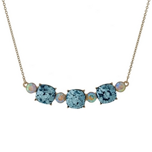 """Gold tone necklace with three light blue glitter squares. Approximately 16"""" in length."""