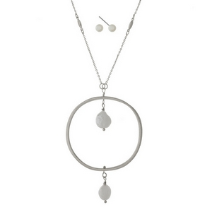 """Silver tone necklace set with a freshwater pearl bead and open circle pendant and matching fishhook earrings. Approximately 32"""" in length."""