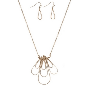 "Gold tone necklace set with a teardrop shaped pendant and matching fishhook earrings. Approximately 32"" in length."