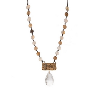 "Brown cord necklace with gray natural stones, a gold tone pendant stamped with ""Faith"" and a clear bead. Approximately 18"" in length."