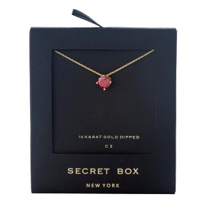 "Secret Box 14 karat gold dipped over brass necklace with a red rhinestone pendant. Approximately 16"" in length."