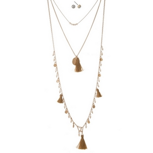 "Gold tone three layer necklace with beige beads and tassels. Approximately 14"" to 32"" in length."