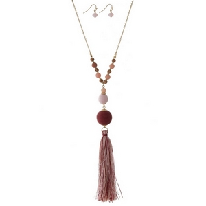 "Gold tone necklace set with burgundy thread wrapped beads and a two tone thread tassel. Approximately 30"" in length."