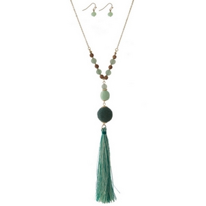 """Gold tone necklace set with green thread wrapped beads and a two tone thread tassel. Approximately 30"""" in length."""