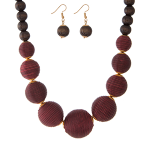 """Burgundy thread wrapped and brown wooden beaded necklace set with matching fishhook earrings. Approximately 18"""" in length."""