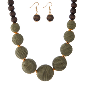 """Olive green thread wrapped and brown wooden beaded necklace set with matching fishhook earrings. Approximately 18"""" in length."""