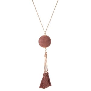 """Rose gold tone necklace with a metallic rose gold thread wrapped pendant and thread tassels. Approximately 30"""" in length."""