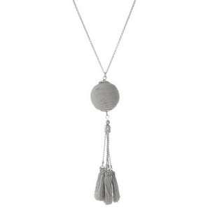 """Silver tone necklace with a metallic silver thread wrapped pendant and thread tassels. Approximately 30"""" in length."""