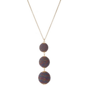 """Gold tone necklace with three, metallic multicolored thread wrapped beads. Approximately 30"""" in length."""