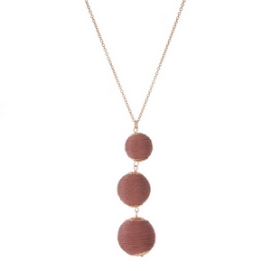 """Rose gold tone necklace with three, metallic rose gold thread wrapped beads. Approximately 30"""" in length."""