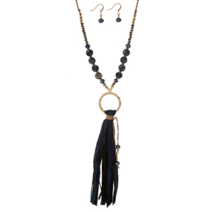 """Gold tone necklace set with a black faux leather tassel, a beaded chain and matching fishhook earrings. Approximately 32"""" in length."""