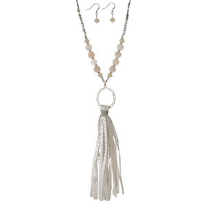 """Silver tone necklace set with a white faux leather tassel, a beaded chain and matching fishhook earrings. Approximately 32"""" in length."""