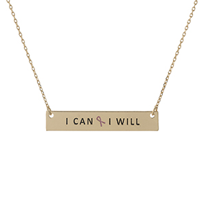 "Dainty gold tone, Breast Cancer Awareness necklace with a bar pendant, stamped with ""I Can & I Will."" Approximately 16"" in length."