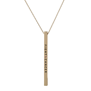 "Dainty gold tone, Breast Cancer Awareness necklace with a vertical bar pendant, stamped with ""Fight Cancer."" Approximately 18"" in length."