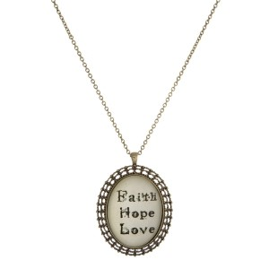 "Metal necklace with a Victorian pendant that says ""Faith Hope Love."" Approximately 30"" in length."
